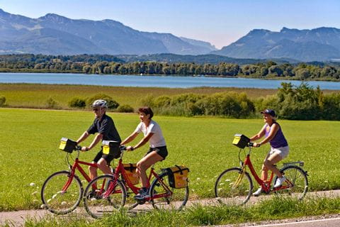 Cyclists on cycle path in Breitenbrunn at Lake Chiemsee